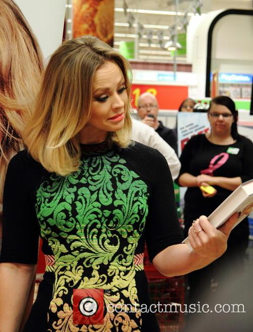 Kimberley Walsh signs copies of her autobiography entitled...
