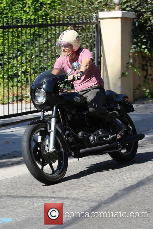 Olivier Martinez riding his motorbike