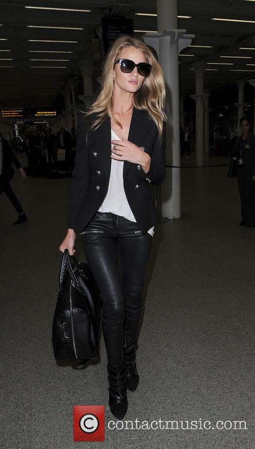 Rosie Huntington-Whiteley and Jason Statham arriving at Kings Cross Station