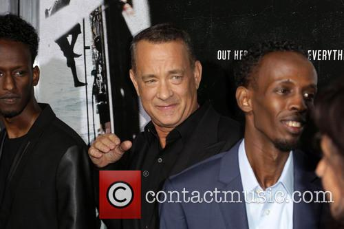 Mahat M. Ali, Tom Hanks and Barkhad Abdi 7
