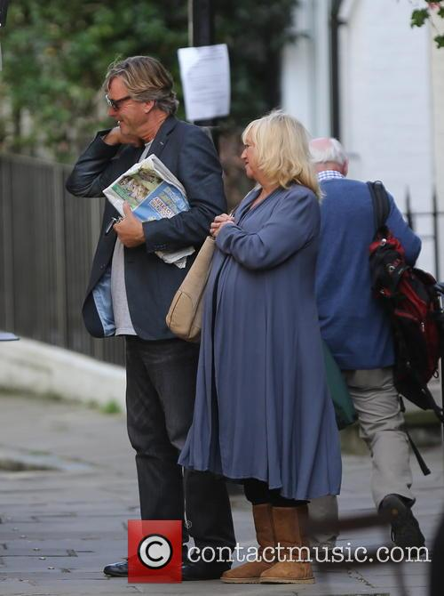 Richard and Judy enjoy a stroll on a...