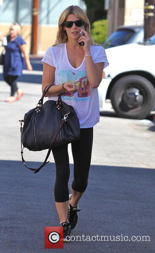 Ashley Greene visits the gym