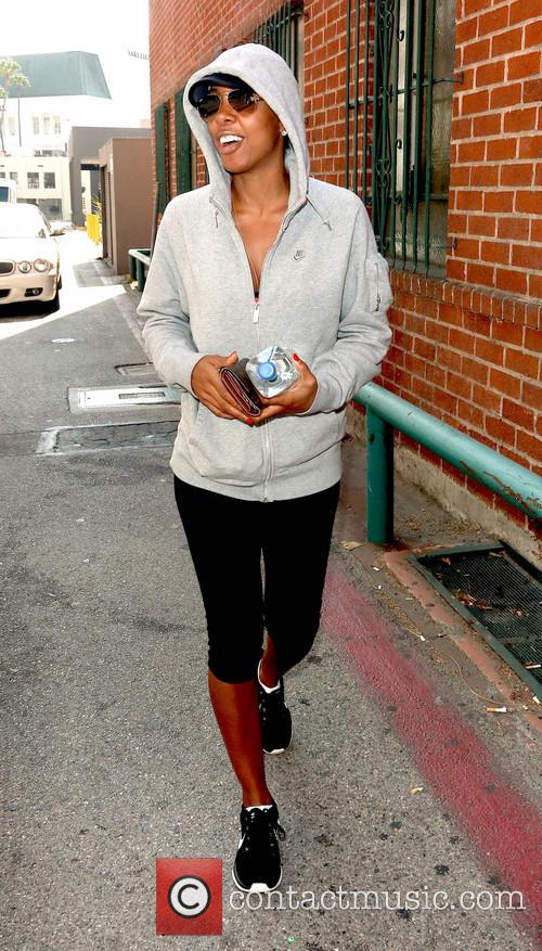 Kelly Rowland wearing a hoodie on Bedford Drive