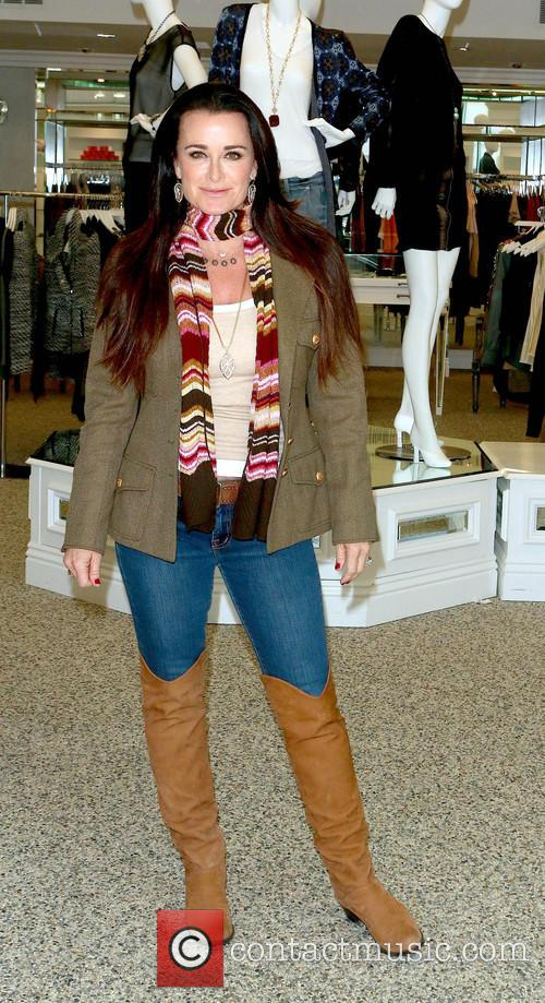 Kyle Richards arriving at her clothing boutique