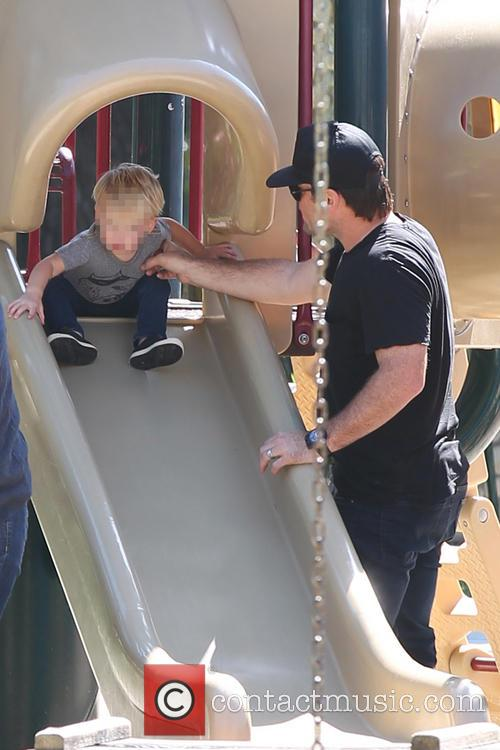 Mike Comrie and son Luca at park
