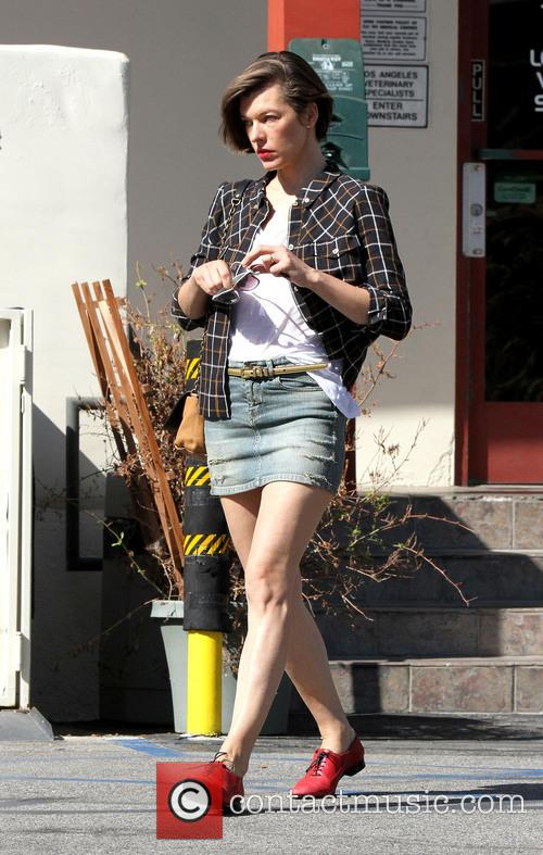 Milla Jovovich and husband Paul W. S. Anderson pick up their dogs