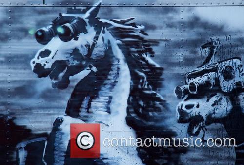 British graffiti artist Banksy gets political in his...