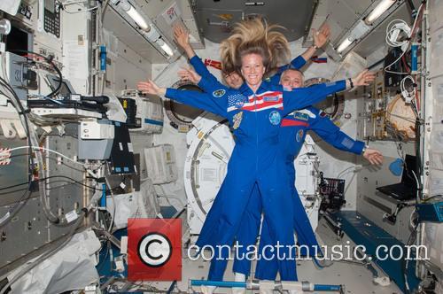 Astronaut Karen Nyberg With Cosmonaut Fyodor Yurchikhin and...