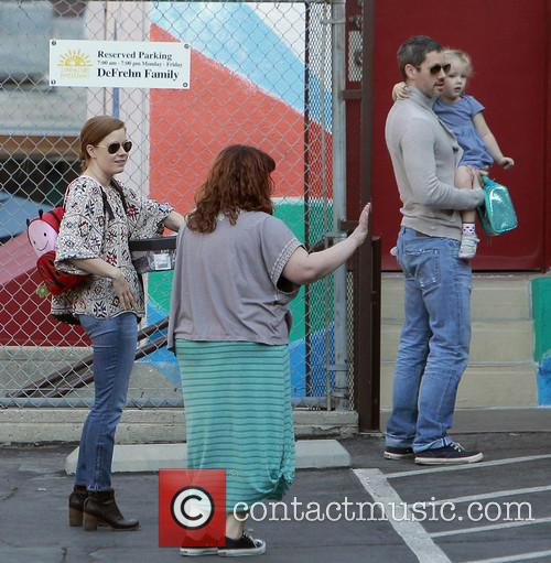 Amy Adams and family arrive for a school...