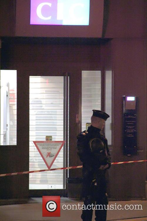 An armed man entered a CIC Bank in...