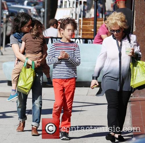 Sara Gilbert leaving Trashy Lingerie with her family