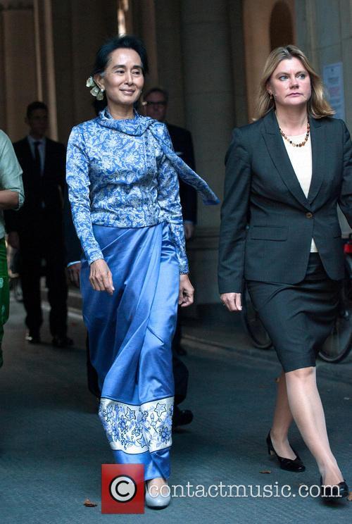 Aung San Suu Kyi (l) and Justine Greening (r) 2