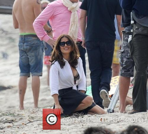 Salma Hayek shows off her curves on the...