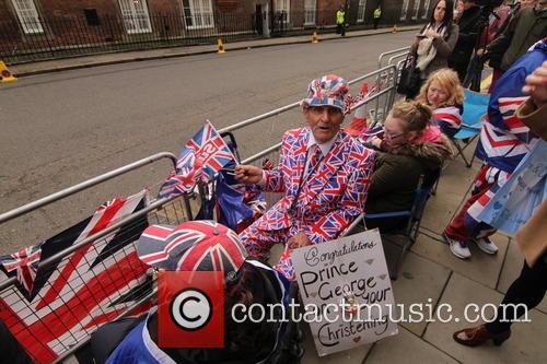 Royal fans and spectators wait outside St. James'...