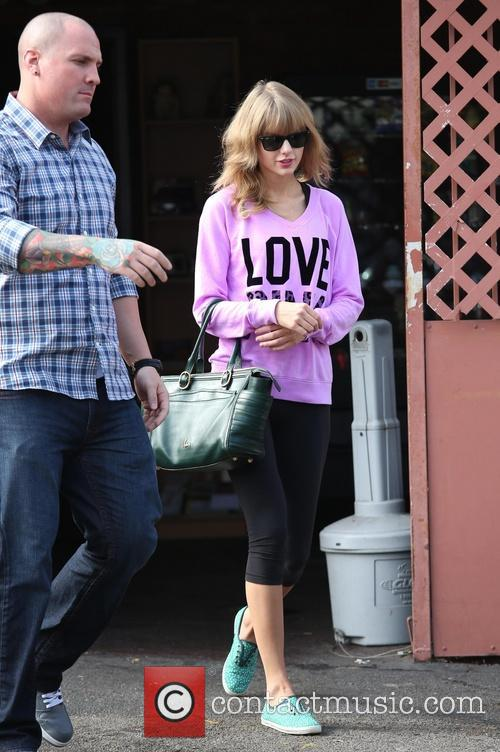 Taylor Swift exits her dance rehearsal studio wearing...