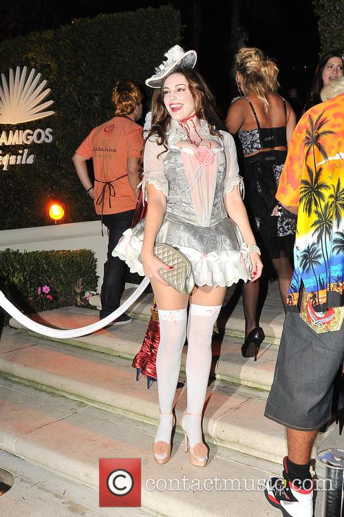 Kelly Brook attends a costume party