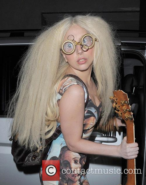 Lady Gaga leaves her hotel and arrives at a studio, wearing vintage Dolce & Gabbana and a backpack given to her by fellow musician Will.i.am
