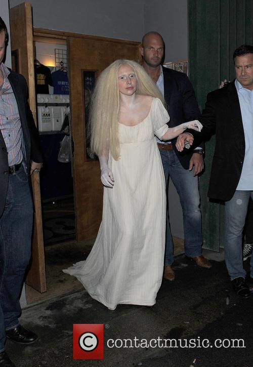 Lady Gaga leaving a recording studio wearing what appeared to be a nighty and covered in white paint