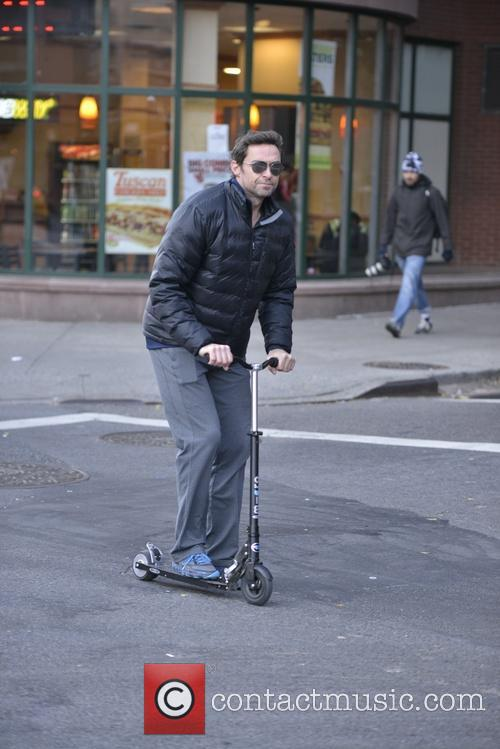Hugh Jackman riding his scooter in Manhattan