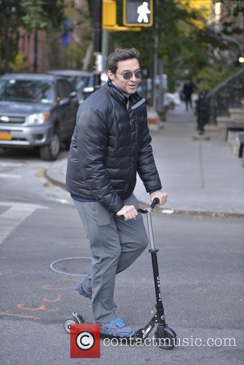 Hugh Jackman riding his scooter in Manhattan