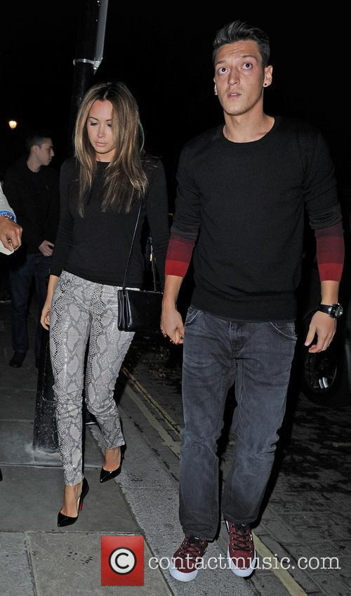 Mesut Oezil and girlfriend Mandy Capristo arrive for...