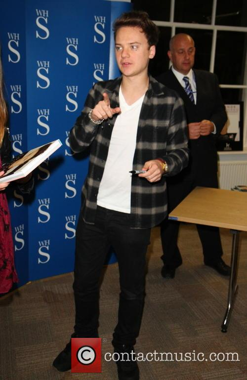 Conor Maynard signs copies of his new book...