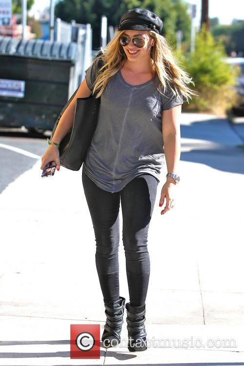 Hilary Duff goes to an office building in...