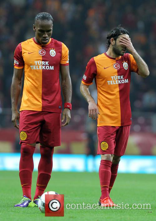 Didier Drogba and Selcuk Inan 9