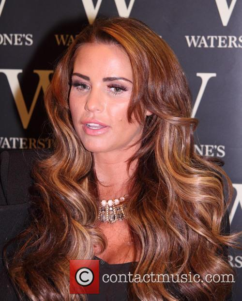 Katie Price signs copies of her new autobiography,...