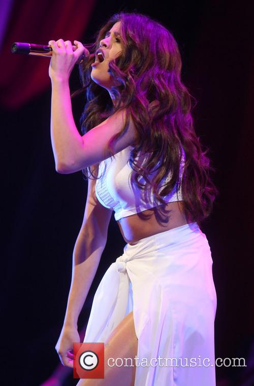 Selena Gomez performing live in concert