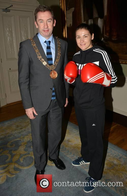 Olympic gold medal boxer Katie Taylor poses with...