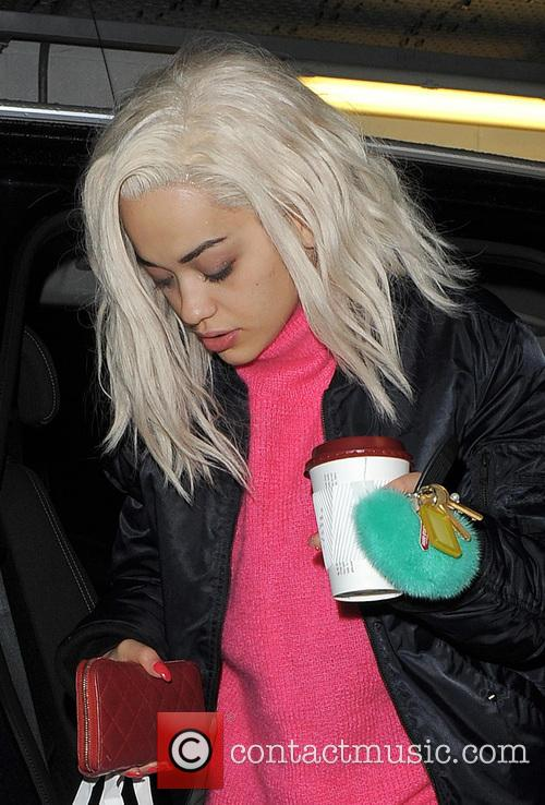 Rita Ora arrives home looking very weary, and...