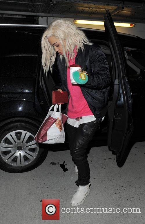 Rita Ora arrives home looking very weary, and drops her sunglasses as she gets out of her car