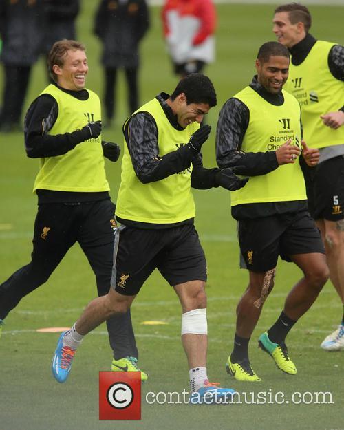 Luis Suarez trains with a bandage below his...