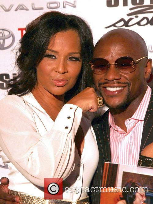 Lisaraye and Floyd Mayweather Jr.