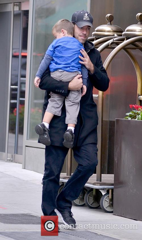 Carson Daly carries his sleeping son Jackson