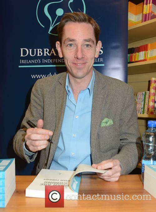 Ryan Tubridy signs his book