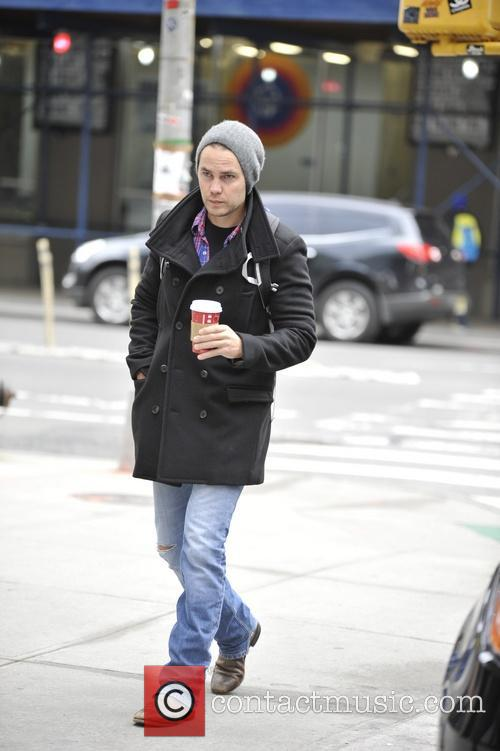 Taylor Kitsch leaves his hotel