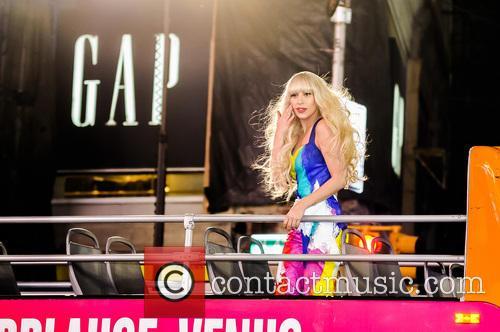 Lady Gaga rides a double decker bus