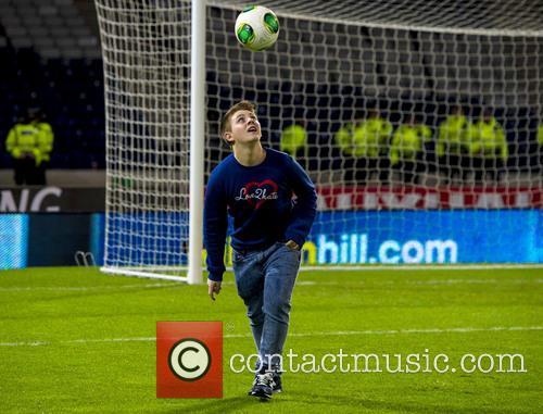 Nicholas McDonald shows off his football skills at...