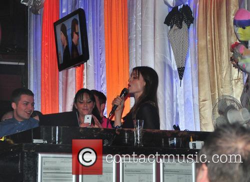 Sophie Ellis-Bextor performs in a nightclub.