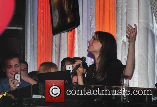 Sophie Ellis-Bextor performs in a nightclub.