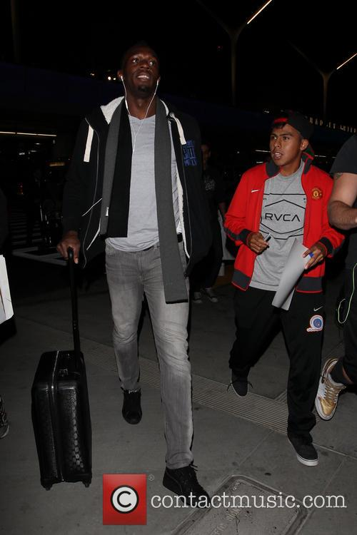 Usain Bolt arrives at LAX airport