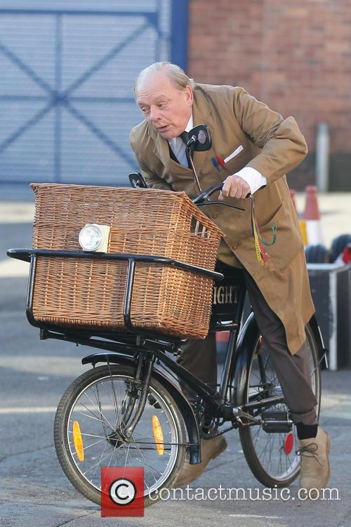 David Jason riding bicycle on 'Still Open All Hours' set