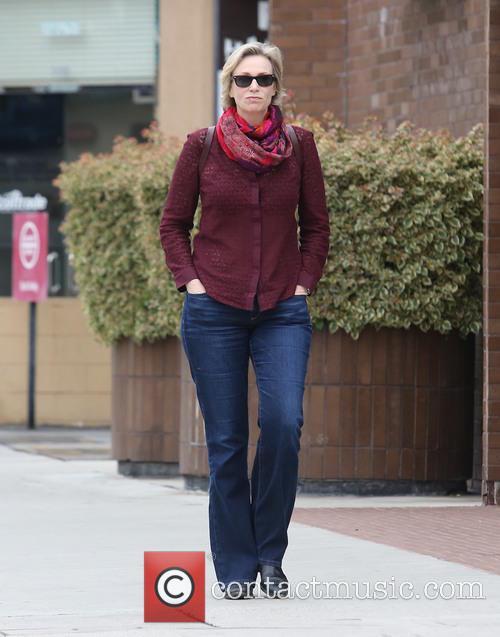 Jane Lynch takes a walk alone