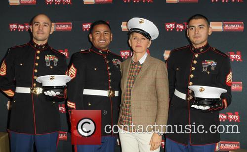 Staff Sergeant Victor Pozo, Sergeant Antonio Sanchez, Ellen Degeneres and Gunnery Sergeant Phillip Campo 2