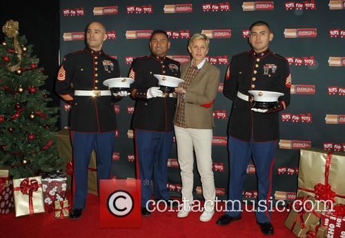 Staff Sergeant Victor Pozo, Sergeant Antonio Sanchez, Ellen DeGeneres and Gunnery Sergeant Phillip Campo 3