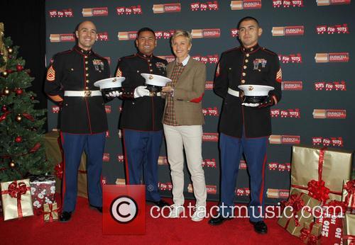 Staff Sergeant Victor Pozo, Sergeant Antonio Sanchez, Ellen Degeneres and Gunnery Sergeant Phillip Campo 4