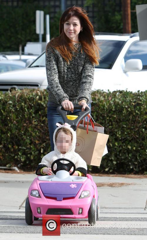 Alyson Hannigan out with her family