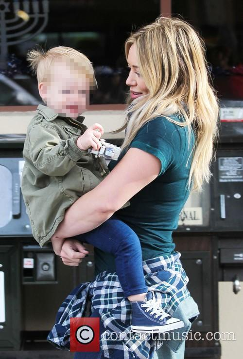 Hillary Duff and husband Mike Comrie take their...